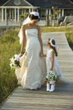 Bride+and+flower+girl+walking.