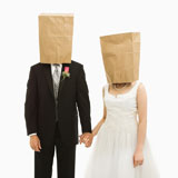 Wedding+couple+with+bags+over+heads.