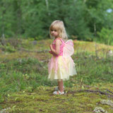 Young+girl+in+a+fairy+costume+standing+in+the+wilderness