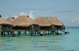 Thatched+buildings+on+stilts+built+in+the+sea%2C+Moorea%2C+Tahiti%2C+French+Polynesia%2C+South+Pacific