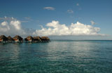Panoramic+view+of+thatched+buildings+on+stilts+in+the+sea%2C+Moorea%2C+Tahiti%2C+French+Polynesia%2C+South+Pacific