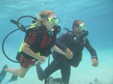 Underwater+view+of+a+young+couple+scuba+diving%2C+Moorea%2C+Tahiti%2C+French+Polynesia%2C+South+Pacific