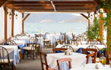 view of empty outdoor restaurant on the seashore, greece