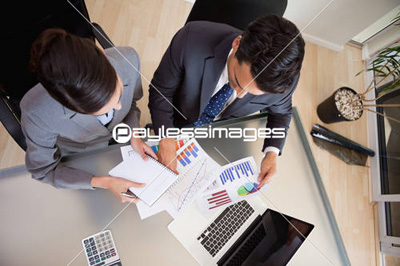 Focused sales persons studying statistics