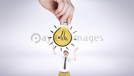 Composite image of hand holding light bulb doodle