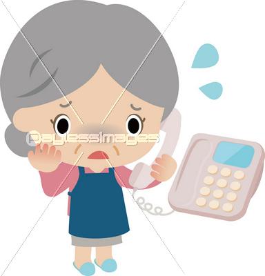電話口でうろたえる高齢の女性の...