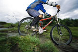 Man+outdoors+on+trails+riding+bicycle+%28selective+focus%29