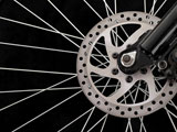 Bicycle+disc+brakes+isolated+on+a+black+background.+