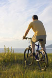Man+riding+his+bicycyle+at+the+sea+in+the+morning+