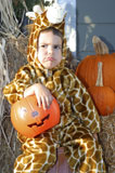 Caucasian+Boy+Wearing+A+Giraffe+Costume+And+Frowning+On+Halloween