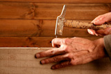 Carpenter+hands+with+hammer+wood+and+nail+on+wooden+background